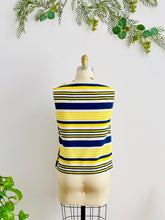 Load image into Gallery viewer, back side of a 1960s yellow and blue striped top with side square buttons on mannequin
