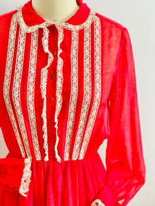 vintage 1970s red lace dress with peter pan collar on mannequin