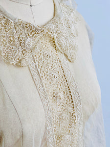 closeup of vintage 1920s chemical lace top on mannequin