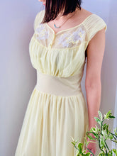 Load image into Gallery viewer, 1960s Yellow sheer lingerie gown with embroidered flowers on model