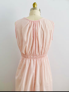 back of a vintage 1940s pink lingerie lace night gown on mannequin