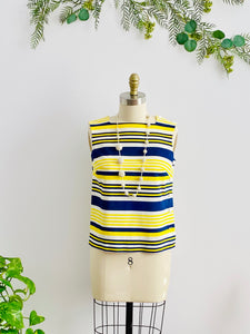 1960s yellow and blue striped top with side square buttons on mannequin