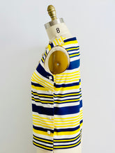 Load image into Gallery viewer, side view of a 1960s yellow and blue striped top with side square buttons on mannequin