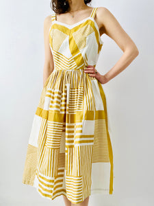 Vintage 1950s mustard color abstract print dress