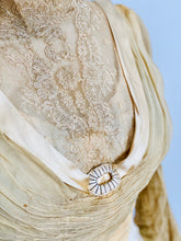 Load image into Gallery viewer, front lace detail of an antique top with silk buckle