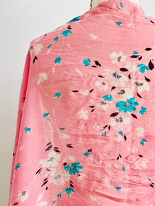 detail of a vintage 1930s pink floral silk scarf display on mannequin