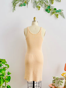 back side of 1920s peach color wool slip dress on mannequin