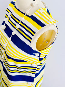 square buttons on a 1960s yellow and blue striped top