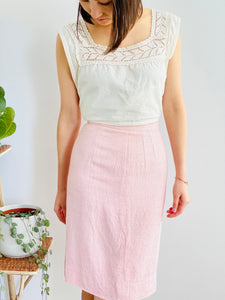 model wearing a 1910s lace top and 1940s pink linen skirt