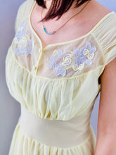 Load image into Gallery viewer, closeup of a 1960s Yellow sheer lingerie gown with embroidered flowers on model