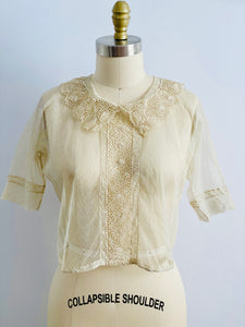 vintage 1920s chemical lace top on mannequin