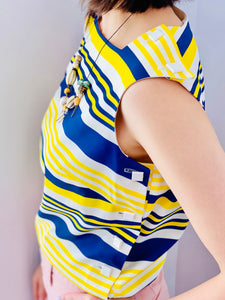 1960s yellow and blue striped top with side square buttons on model