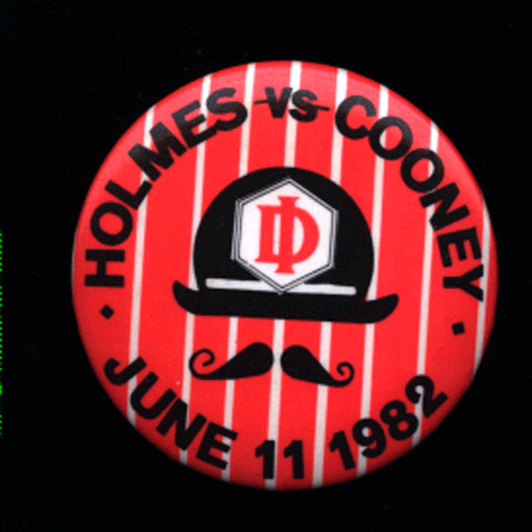 HOLMES, LARRY-GERRY COONEY VINTAGE PIN (1982)