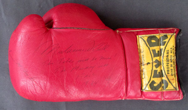 ALI, MUHAMMAD SIGNED TRAINING WORN GLOVE (1974-FOREMAN FIGHT)