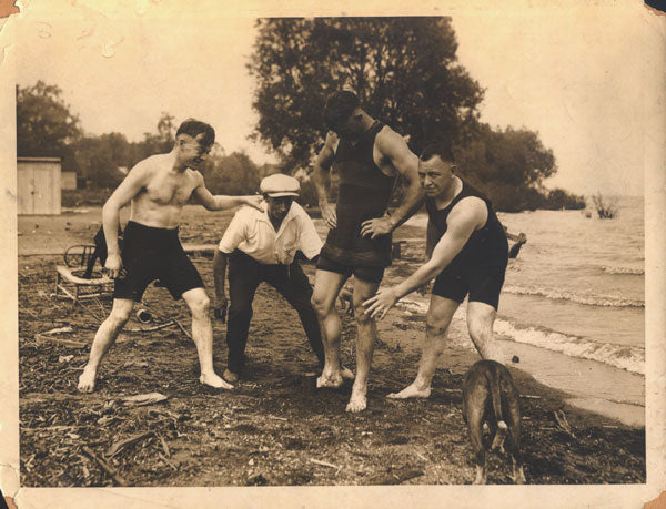 DEMPSEY, JACK TRAINING CAMP WIRE PHOTO (SWIMMING WITH DEFOREST)