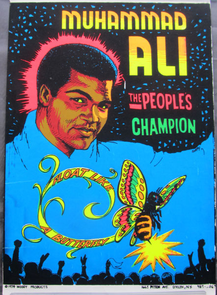 "ALI, MUHAMMAD ""THE PEOPLE'S CHAMPION"" ORIGINAL BLACK LITE POSTER (1974)"