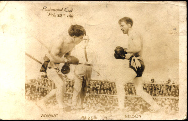 WOLGAST, AD-BATTLING NELSON REAL PHOTO POSTCARD (1910-25TH ROUND)