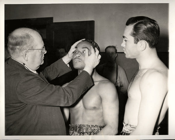 ARMSTRONG, HENRY-BARNEY ROSS WIRE PHOTO (1938-MEDICAL EXAM)