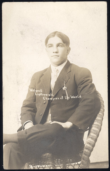 WOLGAST, AD REAL PHOTO POSTCARD (AS WORLD LIGHTWEIGHT CHAMPION)