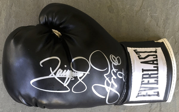 MAYWEATHER, JR., FLOYD & MANNY PACQUIAO SIGNED BOXING GLOVE (PSA/DNA)