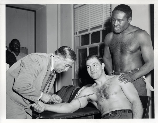 MARCIANO, ROCKY-EZZARD CHARLES I WIRE PHOTO (1954-PRE FIGHT MEDICAL)