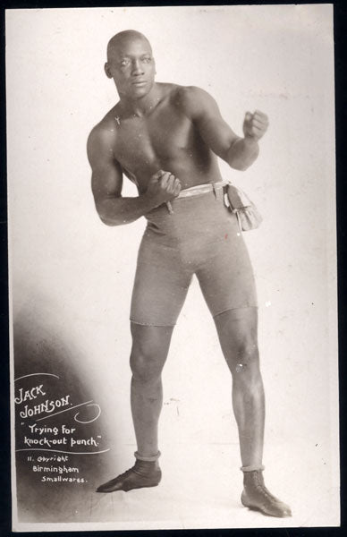 "JOHNSON, JACK ""TRYING FOR KNOCK-OUT PUNCH REAL PHOTO POSTCARD"
