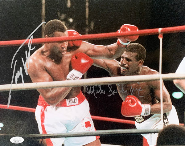 HOLMES, LARRY-MICHAEL SPINKS I SIGNED LARGE FORMAT PHOTO (1985-JSA)
