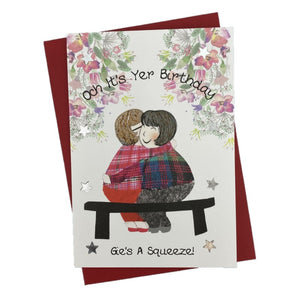 "Scottish Birthday Card with ""Och It's Yer Birthday Gie's A Squeeze"" and two friends hugging on a bench on the front"