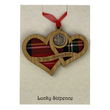 Load image into Gallery viewer, Wooden Plaque shaped with two hearts joined with lucky sixpence and tartan background
