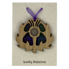 Load image into Gallery viewer, Wooden Plaque in the shape of a thistle with tartan background and lucky sixpence in the centre