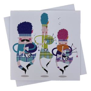 Greetings card with three scottish pipers dancing