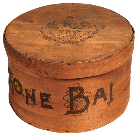 Historic wooden cake box with engraphed logo