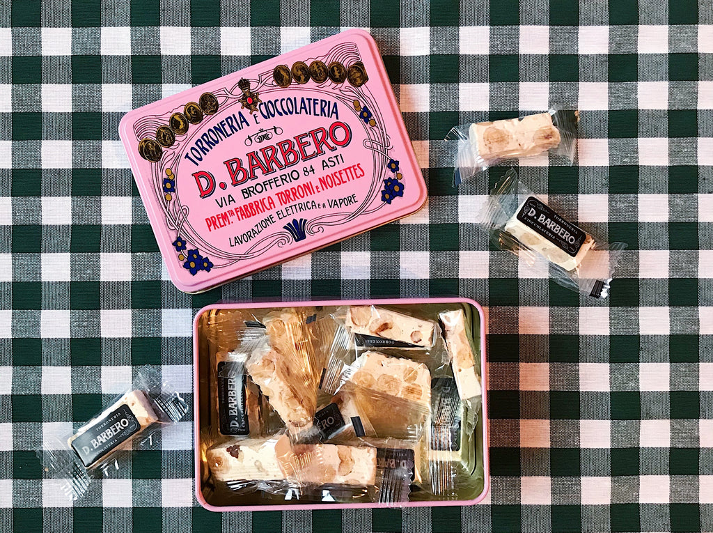 Vintage pink tin from Barbero filled with wrapped Italian nougat