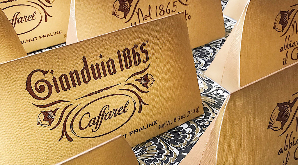 Rows of large Caffarel gianduiotto chocolates in packaging