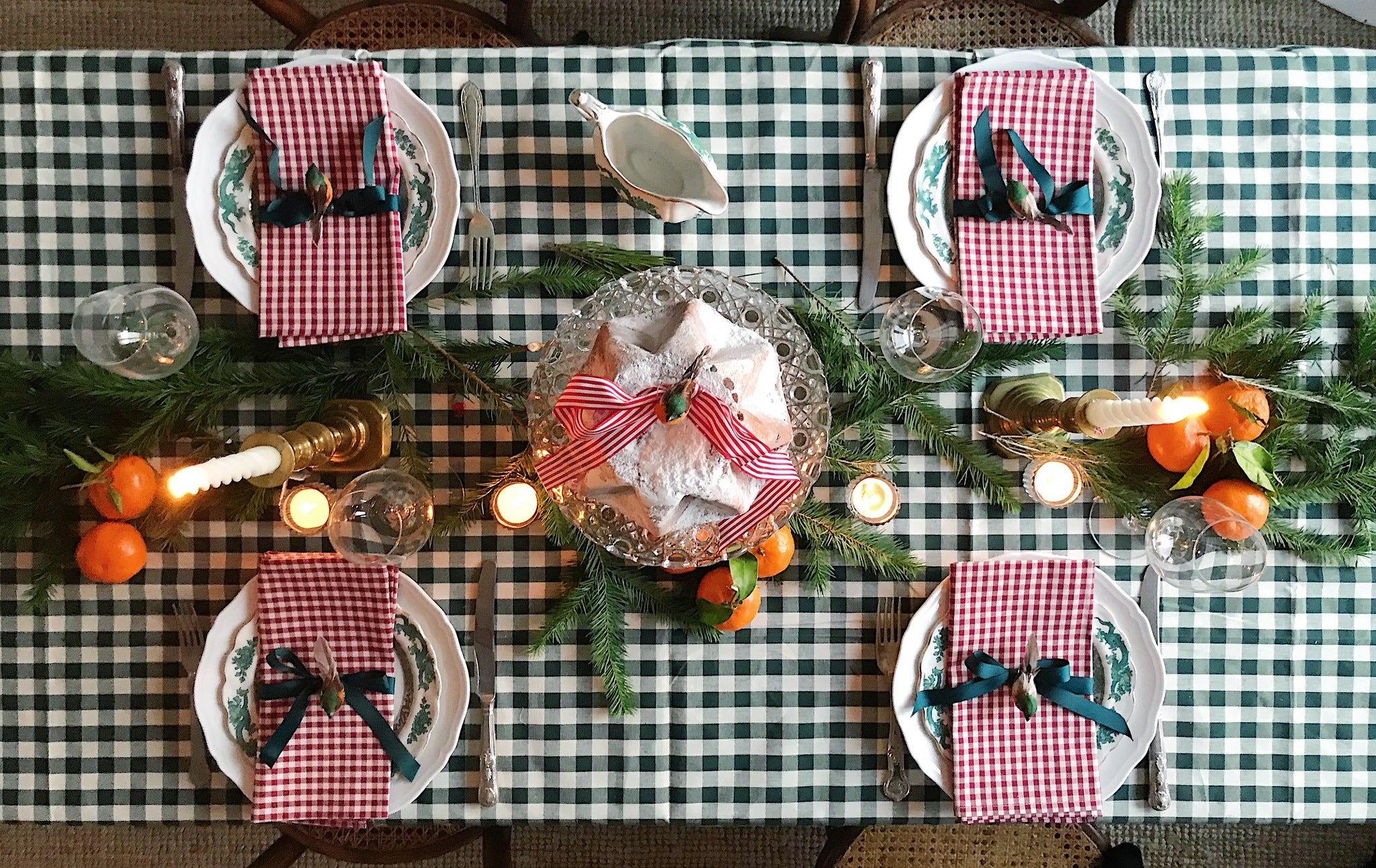Christmas table with gingham table cloth and decorations