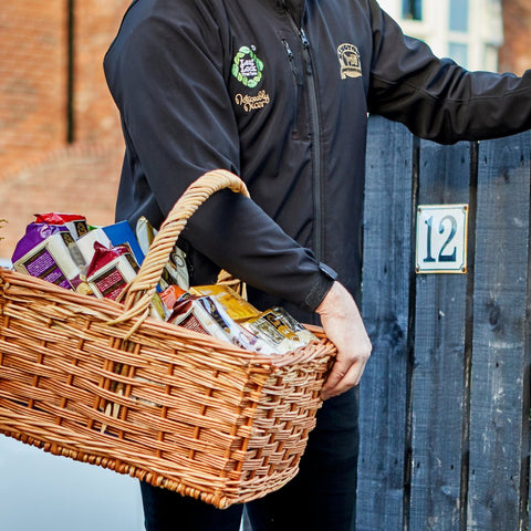 Rington trades person with reed basket