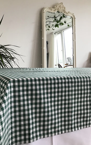 Green checkered table cloth on table