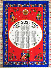 Load image into Gallery viewer, Alpine-style 2021 calendar tea towel from South Tyrol in blue and red colours