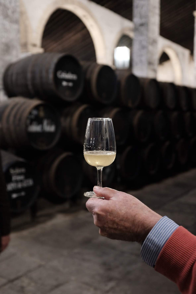 Juan Carlos Gutierrez Colosia holding a glass of freshly extracted Fino.