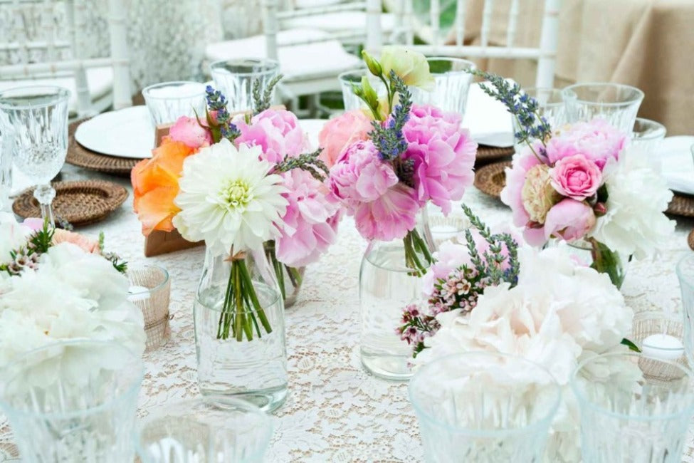 Table setting with colourful flowers