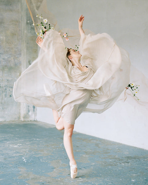 Fine art film photograph of a ballerina caught in motion mid dance by Sarah Carpenter.