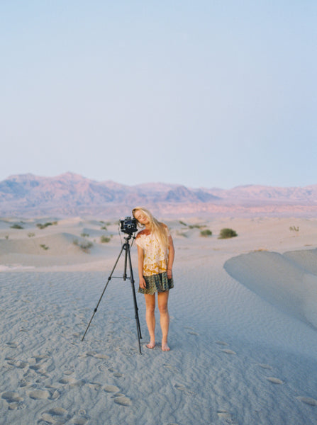 Film photo of Mason Neufeld Photography using a tripod.