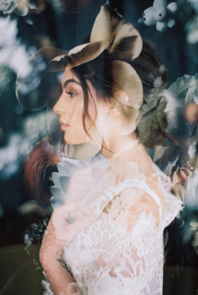 A double exposure of a woman against a floral backdrop by Brian D Smith film photographer.