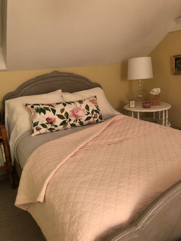 Ann Marie's lovely pink bed with floral pillow