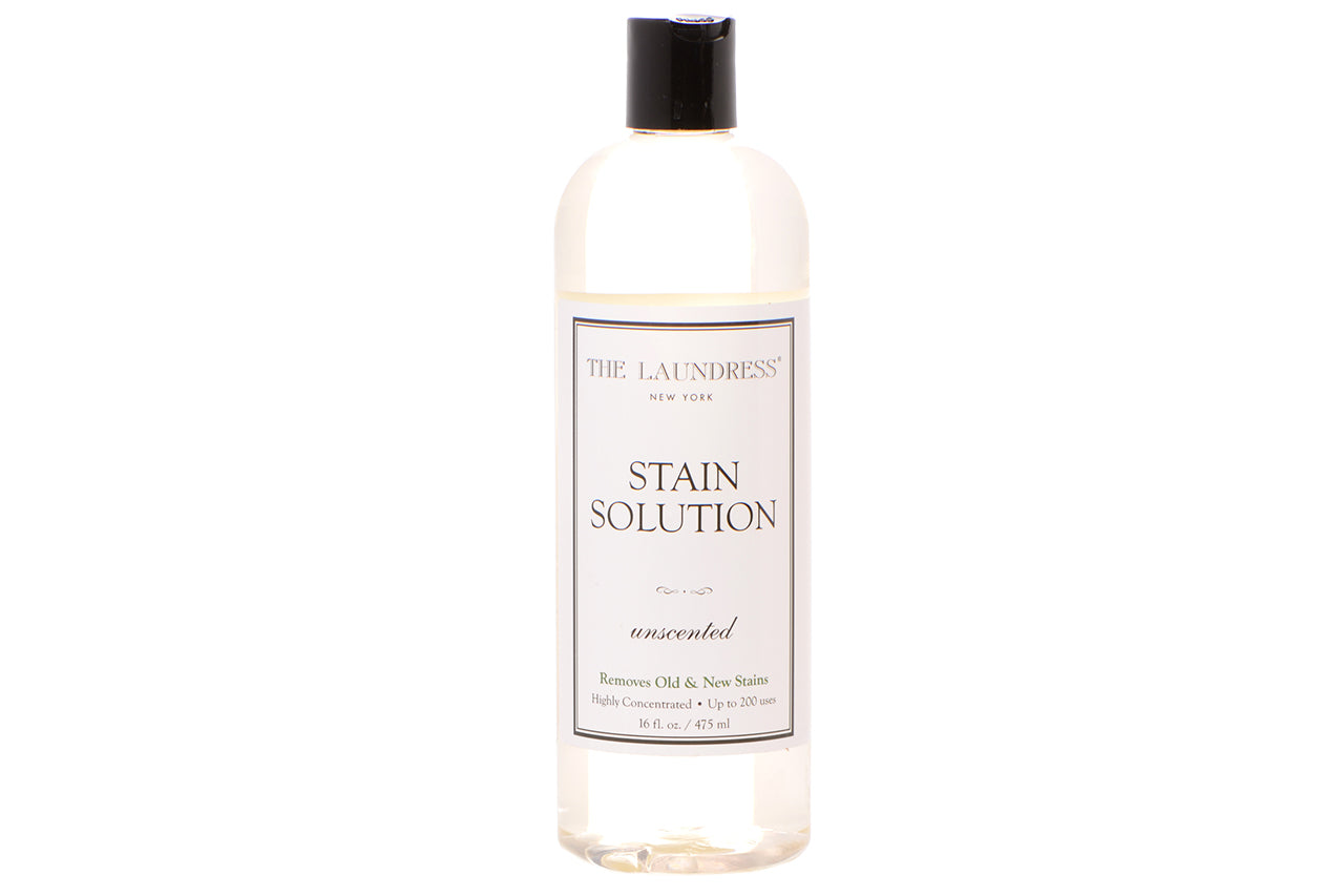 16 fl. oz. bottle of Stain Solution on a white background. Bottle is clear plastic with a disc dispensing top.