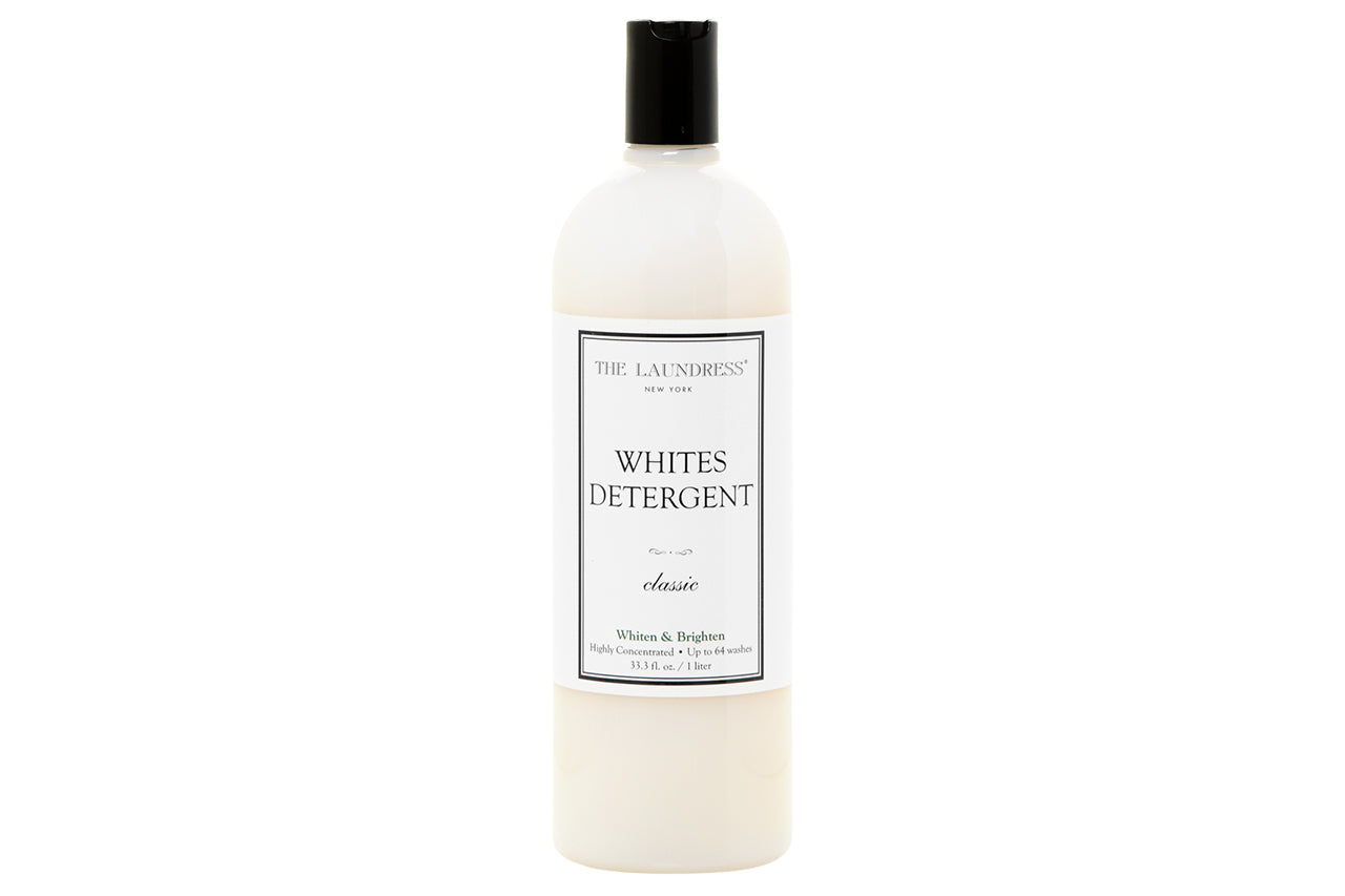 33.3 fl. oz. bottle of The Laundress Whites Detergent, Classic scent on a white background. Bottle is clear plastic with a disc dispensing top.