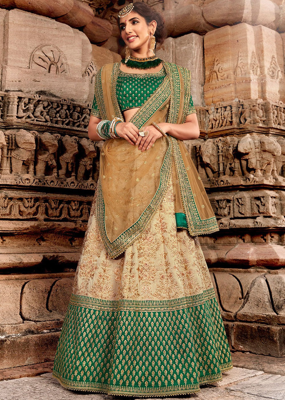 Beige Embroidered Bridal Lehenga with Green Choli