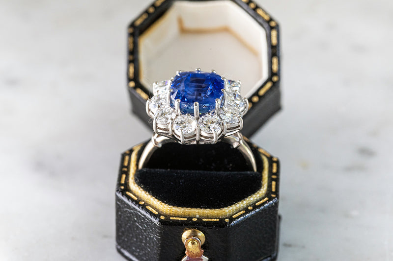 Natural Sapphire Ring surrounded by round Brilliant Cut Diamonds all claw set in 18ct White Gold