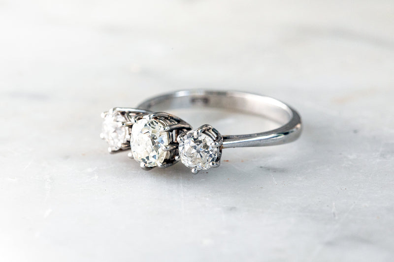 Diamond Trilogy Ring old mine Cut Diamonds set in White Gold.