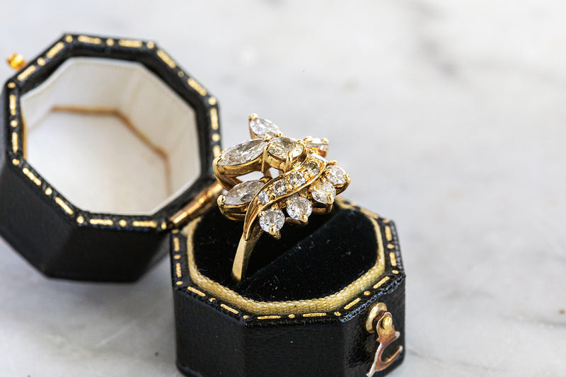 18ct Yellow Gold Ring set with mixed cut and shape Brilliant Cut Diamonds